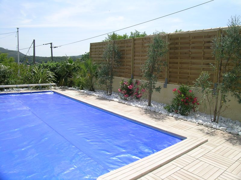 Cr ation de vos terrasses et abord de piscine paysagiste for Amenagement de piscine